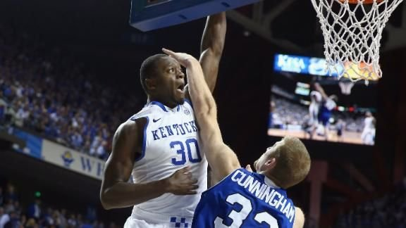 © Associated Press photo. Julius Randle is fouled in the second half against UNC-Asheville.