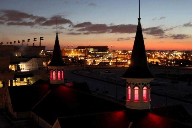 The Twin Spires at Churchill Downs, lit red
