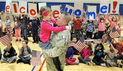 Autumn Schwiederowski is reunited with her dad, Air Force Staff Sgt, Adam Schwiederowski, at surprise reunion at her school in Bridgeville, Pa.  Bob Donaldson/Pittsburgh Post-Gazette