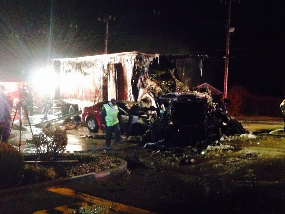 Fiery wreckage from Outer Loop crash that involved a semi truck Tuesday.  Brandon Lopez photo to WDRB News Facebook page.