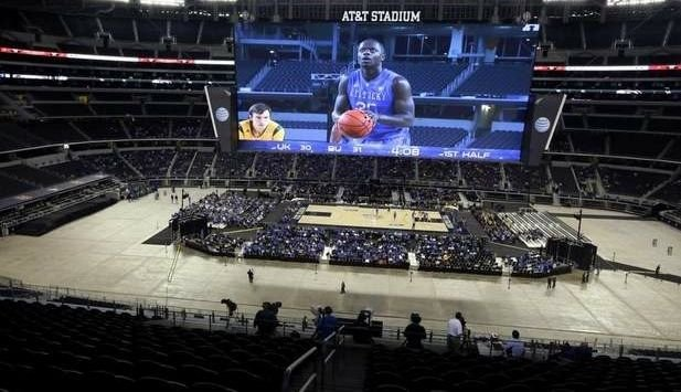 The cavernous AT&T Stadium was barely 10 percent full, thanks to a snowstorm and slow ticket sales, when UK faced Baylor. (Associated Press photo)
