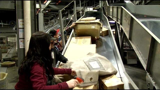 UPS workers sort packages inside the UPS Worldport in Louisville, Ky.
