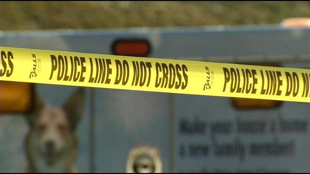 Crime tape surrounded a dumpster at the Valero gas station on Valley College Drive