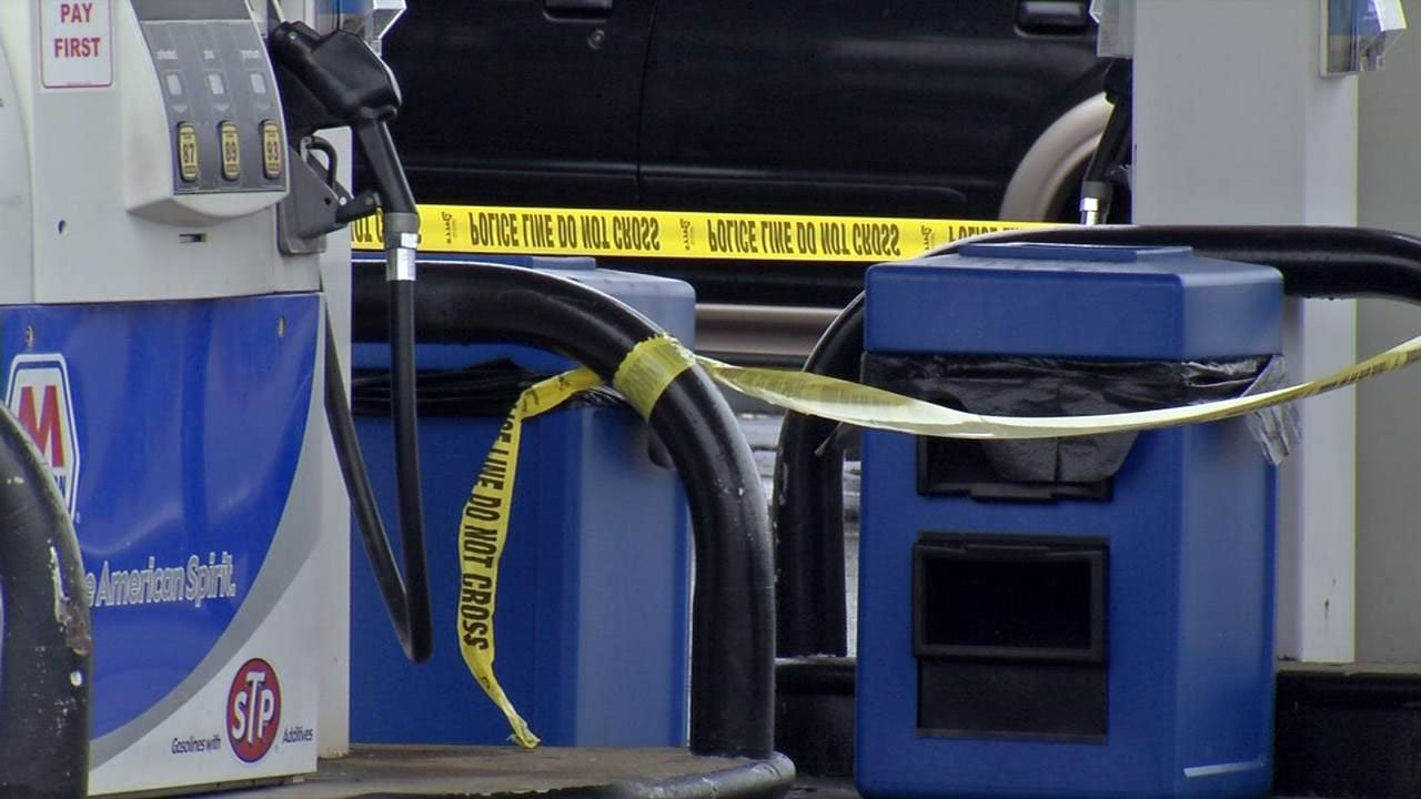 Crime scene tape marked the location at the Marathon gas station where the suspect's vehicle remained.
