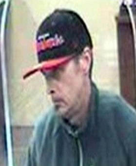 Surveillance image of suspect allegedly involved in robbery of Chase Bank on Preston Hwy. (Photo courtesy of Louisville Metro Police.)