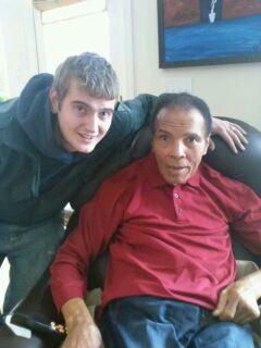 Tony Kelly, a local plumber, with Muhammad Ali