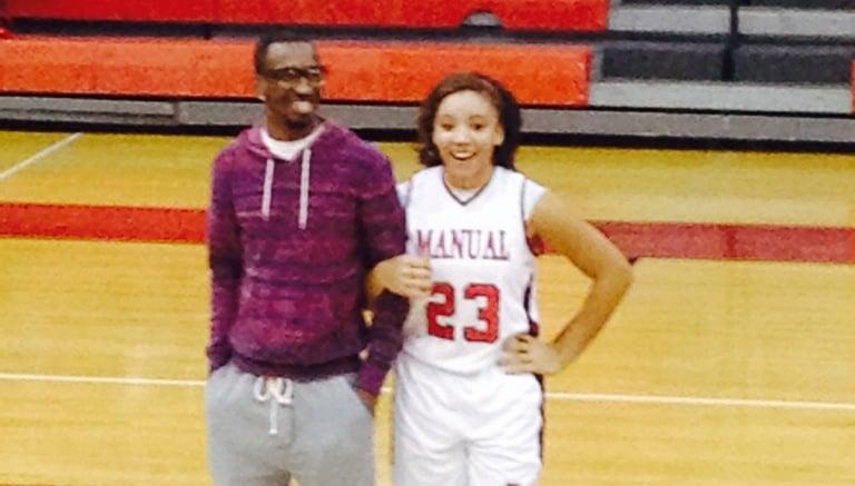 Russ Smith escorts Manual freshman Tonysha Curry.