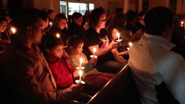 Community members gather for a vigil to honor the Watson family at Calvary Baptist Church Central City, Ky.