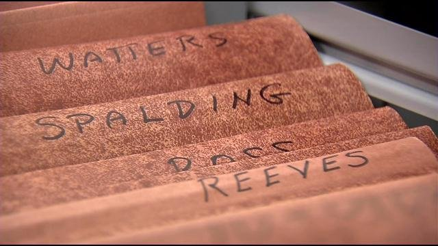 A set of drawers at LMPD Headquarters contains files with the names of people who are missing and on Perry's list.