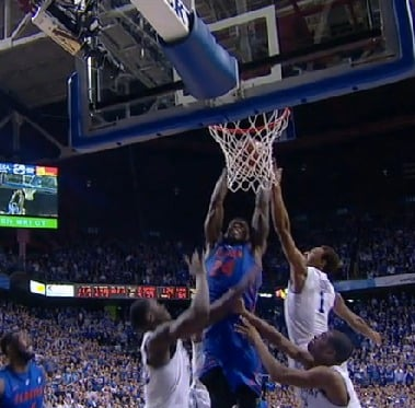 Florida's Casey Prather goes up amid three UK players for a pivotal offensive rebound late in Saturday's victory over UK.