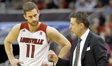 © AP Photo. Luke Hancock scored in double figures for the 13th straight game to help lead Louisville past USF 80-54.