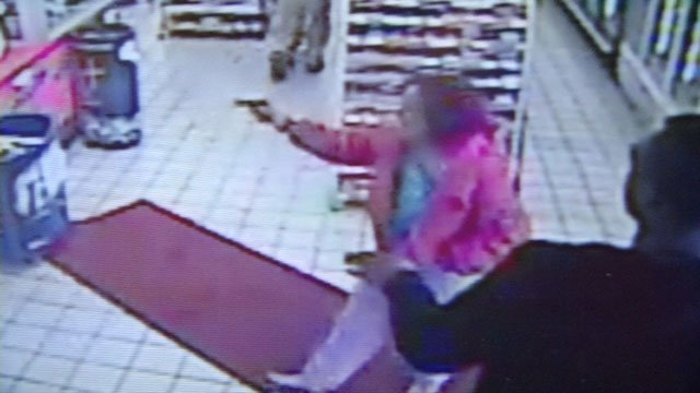 Police say this is surveillance video of Carolyn Denise Marshall pulling a handgun inside Dino's Food Mart.