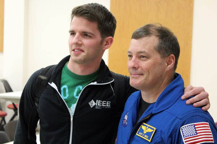 A student poses with Scott Tingle, member of NASA's 2009 astronaut class.