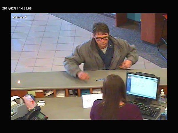 Jeffersonville Police say Benjamin Boswell is the man in this surveillance footage demanding cash at Your Community Bank in Jeffersonville.