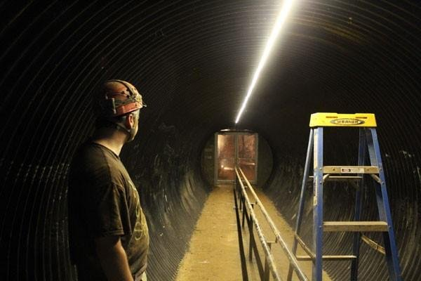 Rob Houchins stands in the basement of the welcome center, about to open the door that leads to Indiana Caverns.