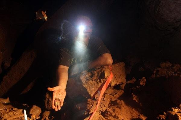 Rob Houchins discovers a bison tooth while inside Indiana Caverns.