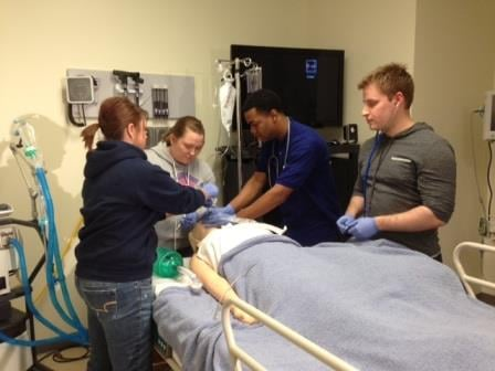Respiratory therapy students practice intubating a patient at Jefferson Community & Technical College