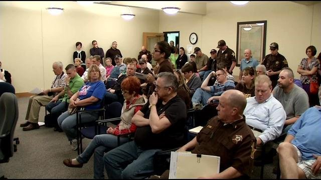 Jennings Co. corrections officers watch county council meeting at government center on Tuesday. WDRB News.