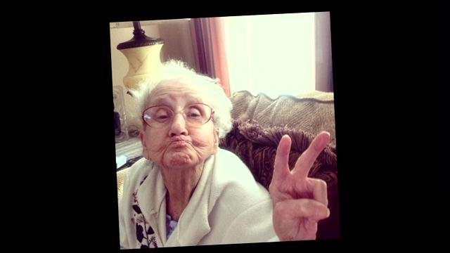 Grandma Betty holds up a peace sign.