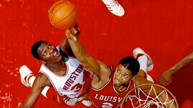 Houston's Hakeem Olajuwon and Louisville's Rodney McCray fight for a rebound (chitwoodandhobbs photo.)