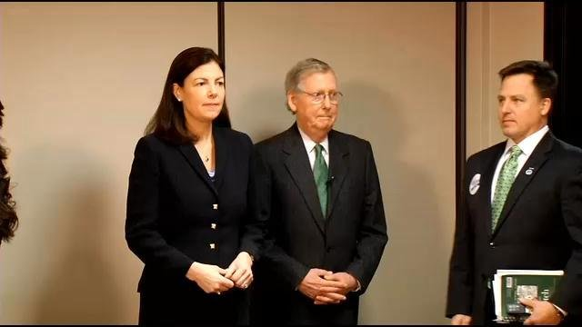 Sen. Kelley Ayotte of New Hampshire, flanked by Sen. Mitch McConnell