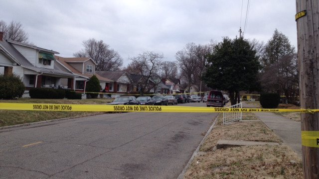 Police found the bodies of a man and woman in the fourth house from the left, on the left side of the screen. This is the 900 block of South 42nd Street, looking south from Garland Avenue. Chris Turner/WDRB News.