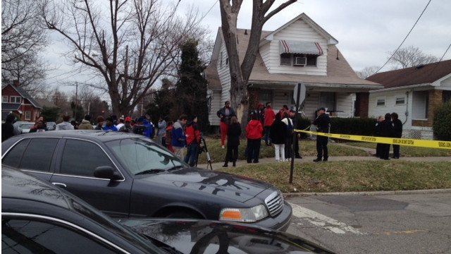Police and victims' family and friends gather at South 42nd Street and Garland Avenue Tuesday. Chris Turner/WDRB News.