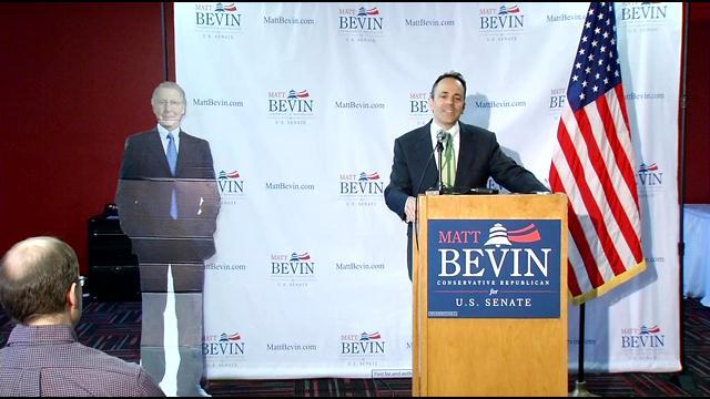 Matt Bevin stands next to cardboard cutout of Sen. Mitch McConnell.