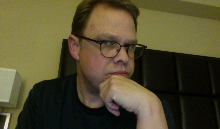 The author, in a selfie, contemplates the whack on his head, and the impact to his writing.