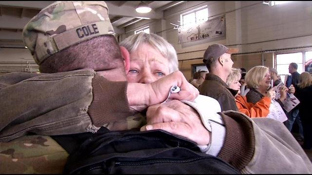 SSgt. Edward Cole of Perryville, Ky., receives a tearful and tight hug from his mother, Marie Oberson.
