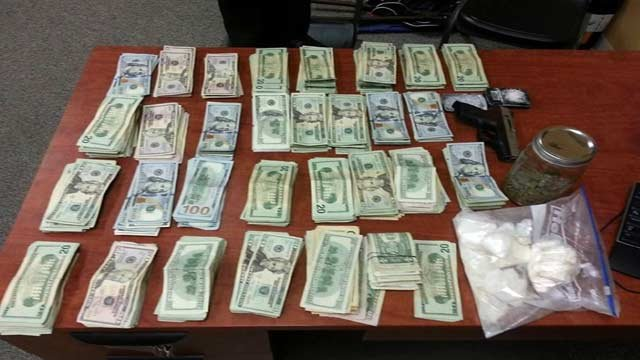 Bardstown Police say they recovered $29,000 in cash, 400 grams of cocaine and a weapon.