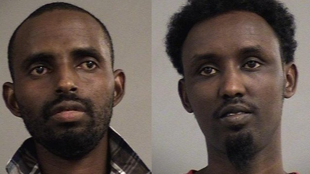 Mumin Hassan and Abdi Hassan were arrested near Watterson Lake Park after police say they were chewing Khat and drinking beer inside of  car.