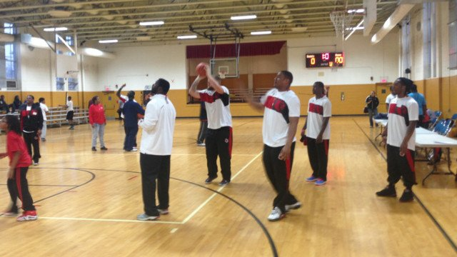 U of L football players visited teens at the California Community Center, April 3.