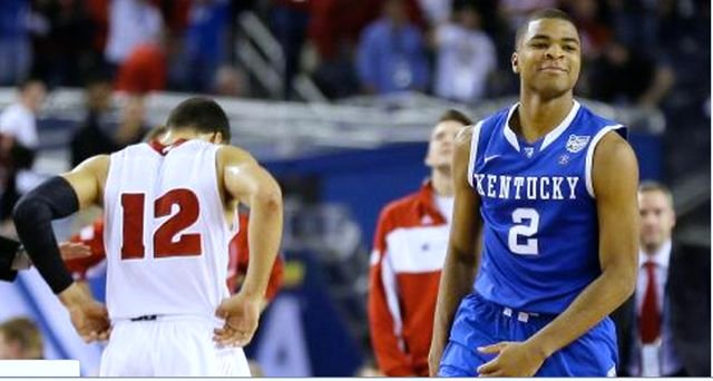 Aaron Harrison (2) made his only three-point shots to lift Kentucky past Wisconsin Saturday night. (Associated Press photo.)