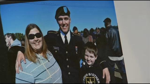 Jacob Sanders with step mother Suzy Sanders, left, and brother Ty Sanders, right at his U.S. Army boot camp graduation in 2012. Sanders family photo special to WDRB News.