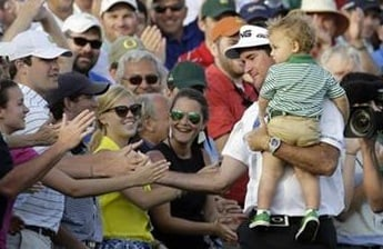© AP photo. Bubba Watson greets fans with his son after winning his second Masters title.