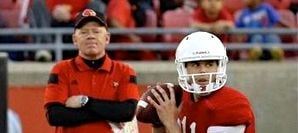 Louisville coach Bobby Petrino has a more settled quarterback situation than Miami does for the season opener on Sept. 1.