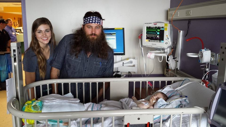 "Willie and Sadie Robertson from ""Duck Dynasty"" visit Karson Friedmeyer at Kosair Children's Hospital."
