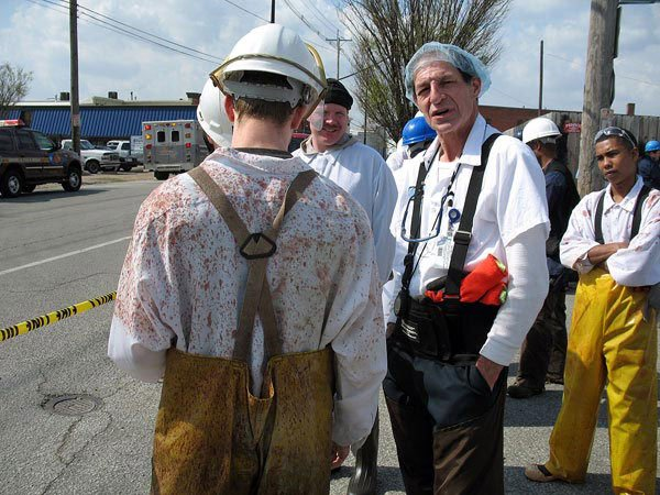JBS/Swift workers bide their time during an evacuation of the plant in 2011