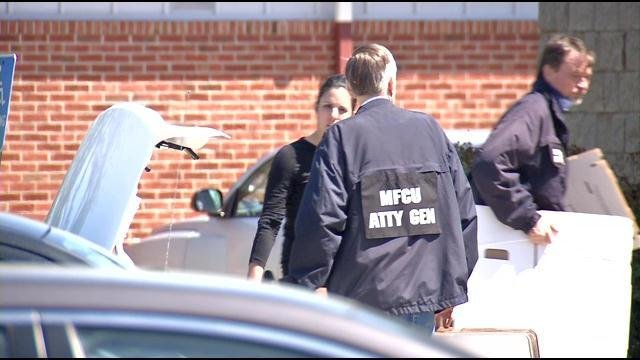 Medicaid Fraud Control Unit officers raid a medical office in Jeffersonville.