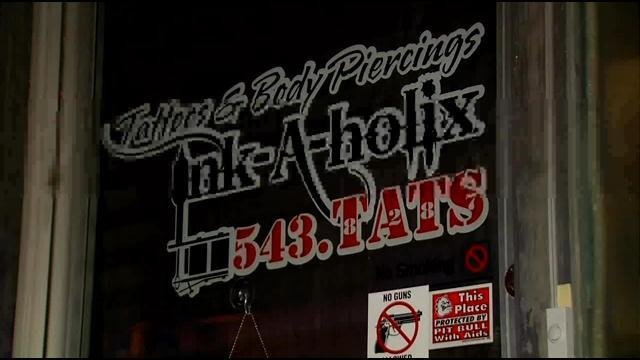 The Drug Task Force ignored the warning posted on the door when they raided the tattoo parlor.