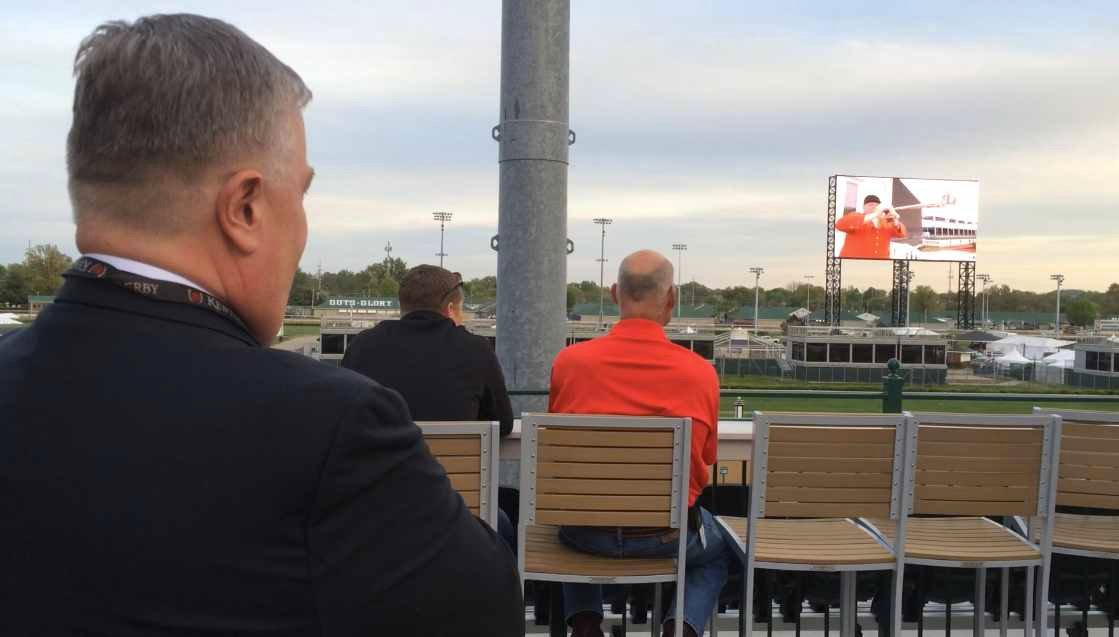Churchill Downs Vice President John Asher watches as the new video board at the track is unveilled.