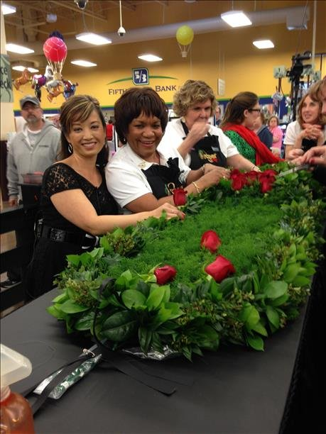 WDRB's Valerie Chinn with the master floral designers.