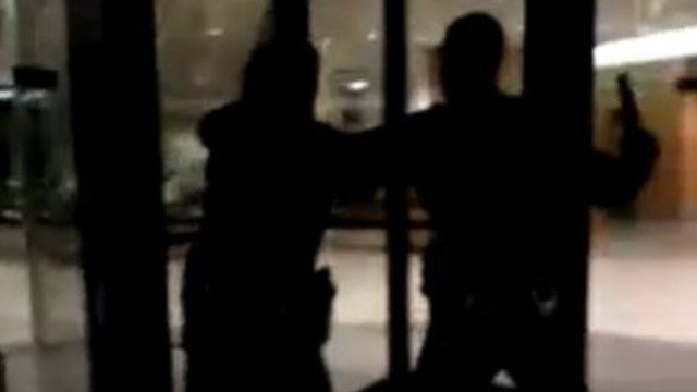 This image is taken from a YouTube video which appears to show a LMPD officer strike a person with a flashlight.