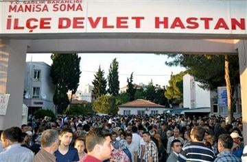 (AP Photo/IHA). People at the entrance of the local hospital after an explosion and fire at a coal mine in Soma, in western Turkey, Tuesday, May 13, 2014.