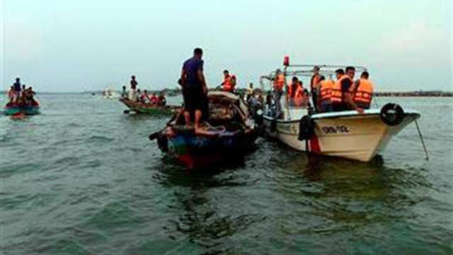 (AP Photo/Sony Ramany). Bangladeshi rescuers look for bodies of victims from the River Meghna after a ferry carrying more than 100 passengers capsized and sank after being hit by a storm in Munshiganj district, Bangladesh, Thursday, May 15, 2014.