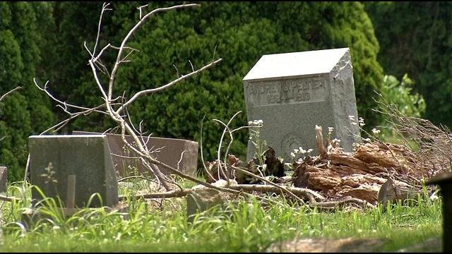 Broken headstones and overgrown grass are spread throughout Eastern Cemetery.