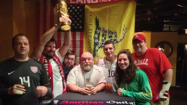 Outlaws gather to pose with a World Cup trophy replica