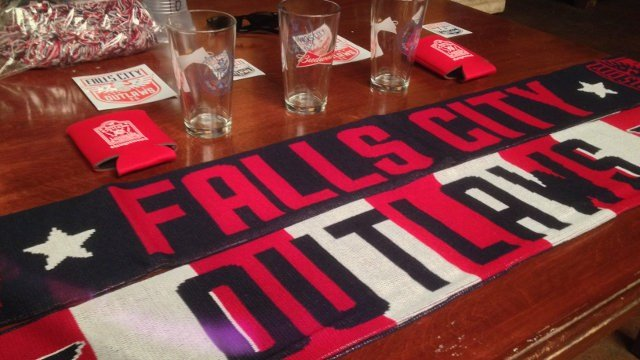 The iconic soccer scarves bearing red, white and blue