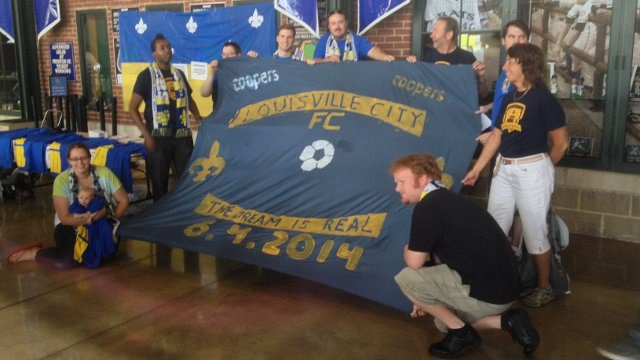 Coopers members pose with an inaugural flag